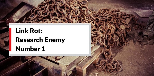 A pile of brown, rotting chain links sits on a pallet on a dirt floor. Link Rot: Research Enemy Number 1